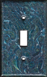 Blues and Greens over black artisan switch plate