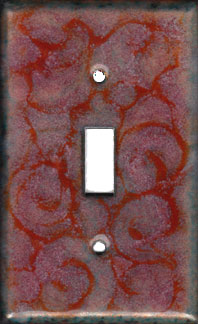 Bright orange swirls over pale opaque orange decorative switch plate covers:$25, d:$35, t:$45
