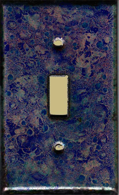 Dark Blue with Bright Blue bits finished with Red decorative switch plate covers
